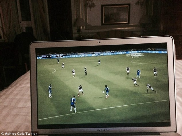 1408408599220 wps 1 Ashley Cole watching the