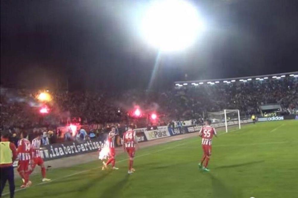 Ερυθρός Αστέρας: Παίκτης χτυπήθηκε από φωτοβολίδα των οπαδών του! (videos)