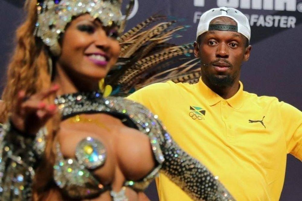 «Καρφώθηκε» στο στήθος καυτής χορεύτριας ο Μπολτ! (photos+videos)
