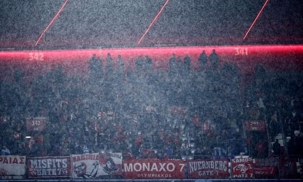 Μπάγερν Μονάχου-Ολυμπιακός: Δυναμική η «ερυθρόλευκη» εξέδρα στο βροχερό Μόναχο (photos)