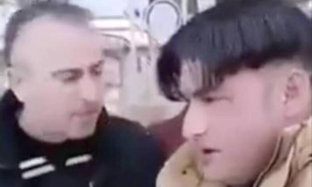 Εισαγγελική παρέμβαση για βίντεο με οπαδό που υποχρεώνει μετανάστη να κάνει τον σταυρό του